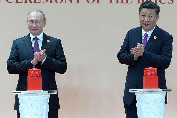Поздравил соткрытием российско-китайского университета в КНР президентРФ Владимир Путин